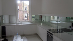 Quartz kitchen worktops and mirror glass splashbacks Fulham