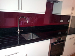 Red Glass Splash Back and Star Galaxy Granite Worktop Farringdon